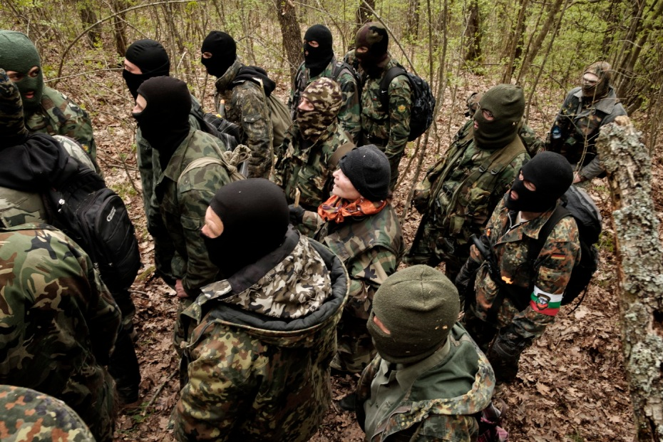 """Some volunteers from the """"Vasil Levski"""" Bulgarian Military Veterans Union and from the """"BNO Shipka"""" are seen patrolling a forest, about 30 kilometers from the border with Turkey. In the center there is a woman who decided to join the group. Yasna Polyana, Bulgaria 2017. © Matteo Bastianelli"""
