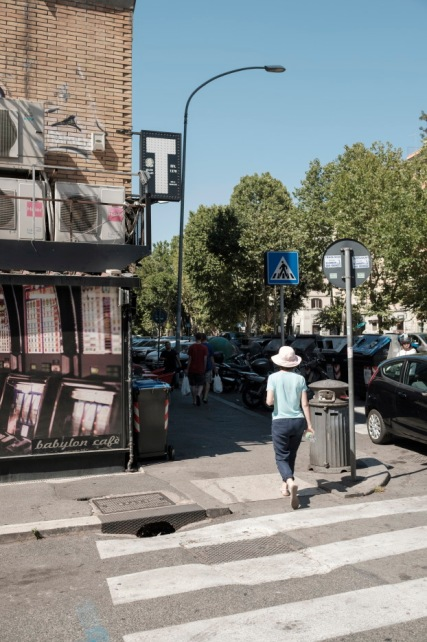 "Some people walk near the ""Babylon cafè"", located at the corner between Ostiense and Giovanni da Empoli streets, one of the places which have been the object of a preventive confiscation order during the ""Babylonia"" operation, that on 23 June 2017 culminated in the arrest of 23 people and in the seizure of assets for a value of € 280 million. Rome, Italy 2017. © Matteo Bastianelli"